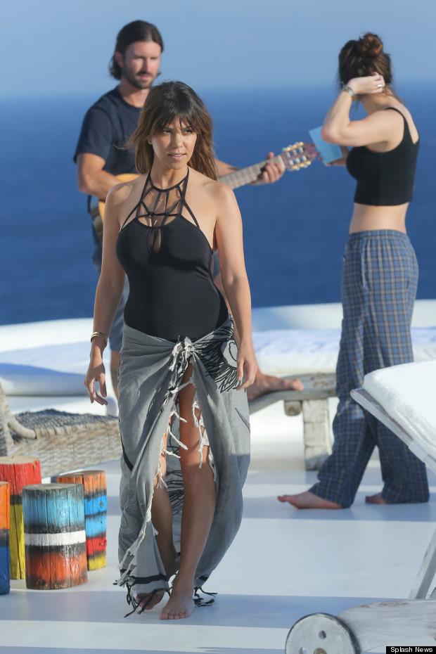 kourtney kardashian does holiday chic style in one piece